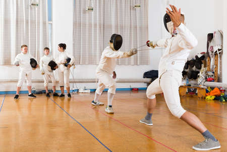Two fencing instructors showing effective techniques