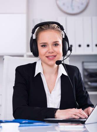 Female helpline operator with headphones
