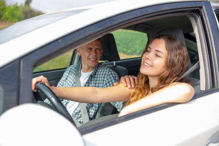 Woman and man talking in car during common trip