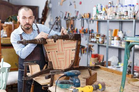 Craftsman measuring vintage armchair