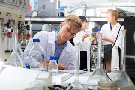 Male scientist working at biochemical laboratory