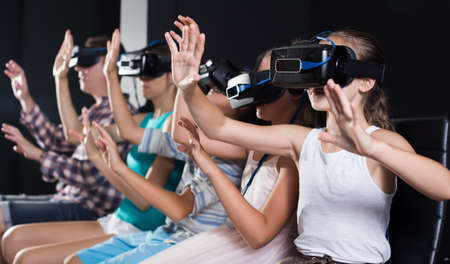 Nice family is watching VR
