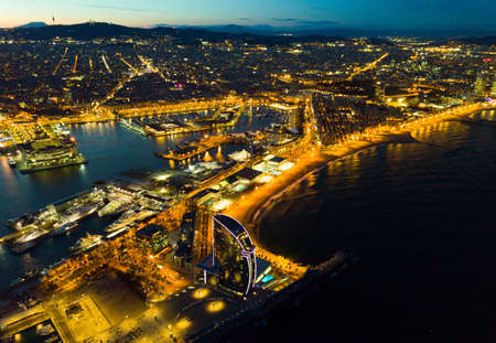 Evening view of Barceloneta and Port Vell. Barcelona.