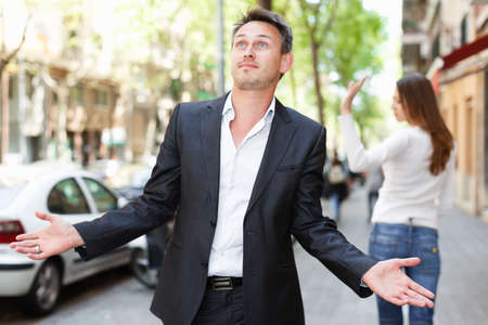 Disappointed man in quarrel with girlfriend