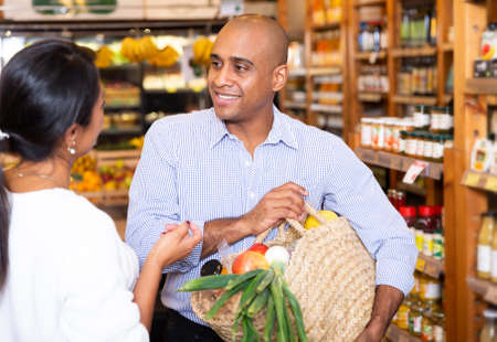 Communication of a man and a woman in grocery supermarket