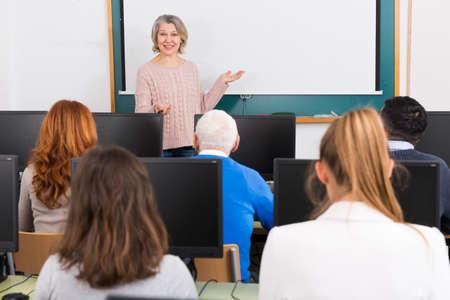 Mature female coach lecturing