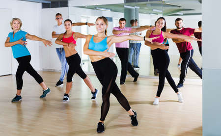 adults of different ages dancing at dance class Stock fotó