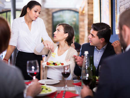 Angry couple conflict with waitress Foto de archivo