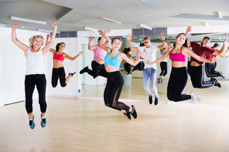 Adults jumping at dance class