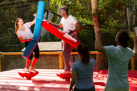 Fun fight between two friends with inflatable logs Imagens