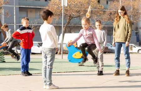 Children skipping on elastic jump rope