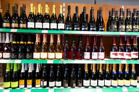 Racks with cava in supermarket of Barcelona Editorial