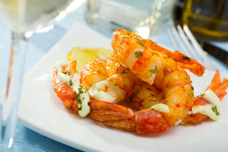 Grilled shrimps with garlic sauce