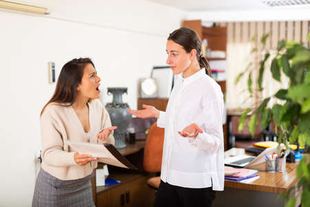 Irritated woman boss scolding manager for incompetence