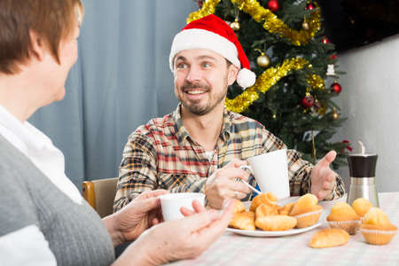 Mother and son Christmas breakfast