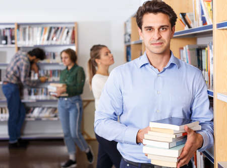Man standing in library