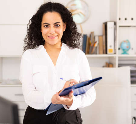 Business woman politely welcoming to office