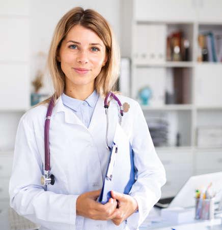adult doctor female working in uniform in room