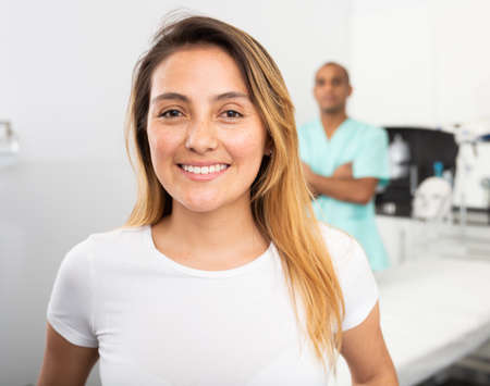 Happy woman client of professional esthetician after procedures