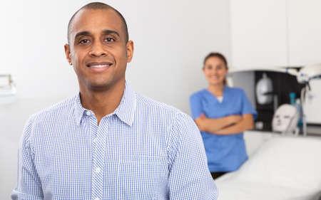 Smiling male client after professional esthetician procedures