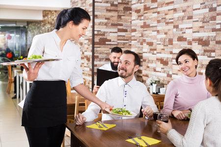 Waitress taking table order at tavern