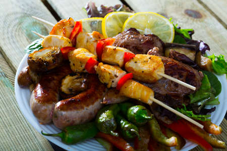 Bulgarian cuisine meshana scara with different grilled meat and vegetables Reklamní fotografie