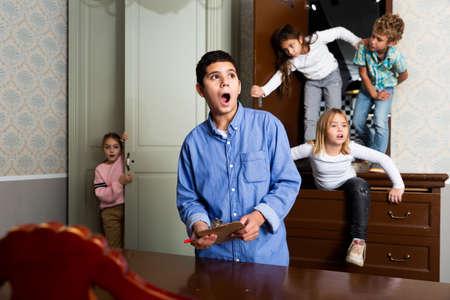 Surprised tween boy solving conundrums in quest room
