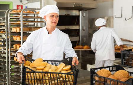 portrait of european male baker in bakery