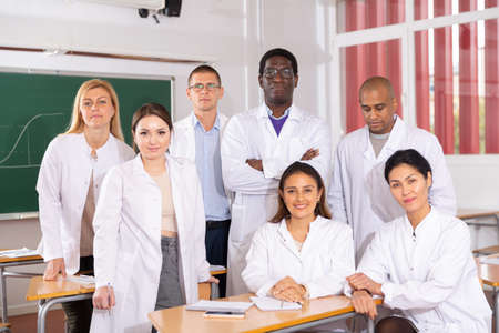 Portrait of a group of happy medical academy students in audience