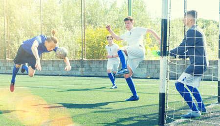Young football player doing header Stock fotó