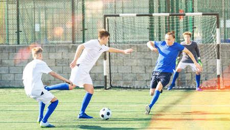 Junior football teams having scrimmage