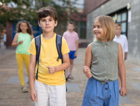 Young girl and boy walking together Stock fotó