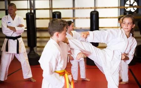 Kids on karate training in gym