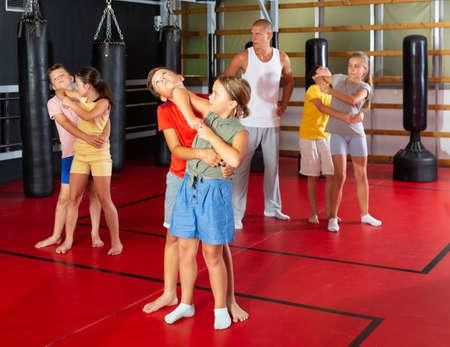 Kids in pairs training elbow strike Stock fotó