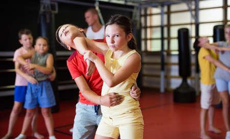 Girls and boys training chin strike in gym Stock fotó