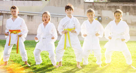Barefoot kids doing kata