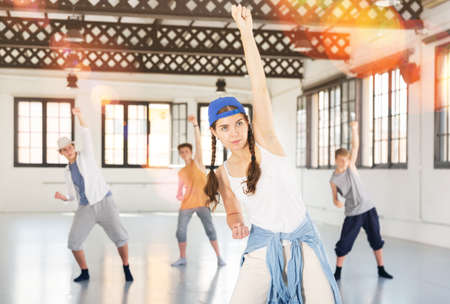 Team of young dancers training moves Stock fotó