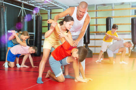 Young boys and girls on self-defence training