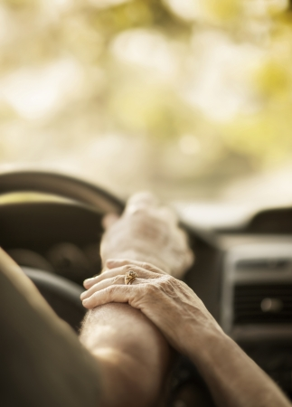 Closeup hands elderly person by car