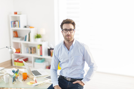 view of an elegant office: young business man at office Stock Photo
