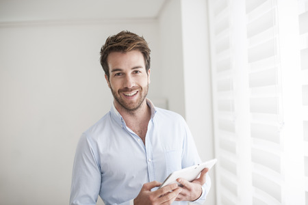 young man using a digital tablet Stock Photo