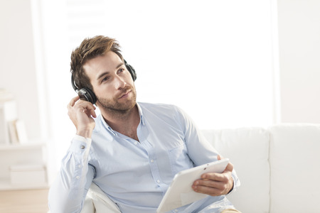 35 years old man: man  listening music with headphone and digital tablet Stock Photo