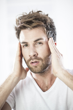 beautycare: closeup portrait of an handsome man examining his face Stock Photo