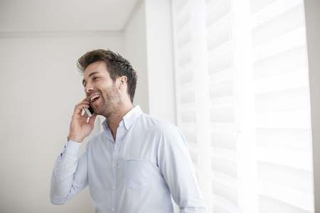30 34 years: young man at phone receives a good news