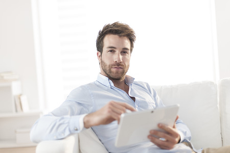 35 years old man: handsome man surfing an tablet