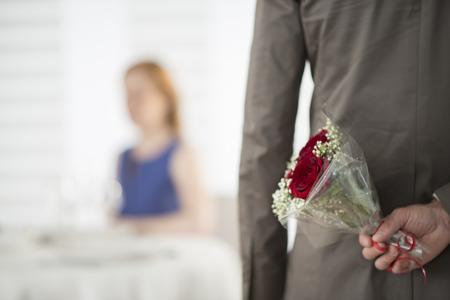 valentine day: romantic dating at restaurant focus on flower bouquet