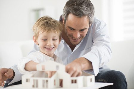 paternity: father and son building a model house