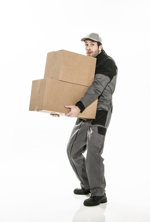 worker carrying too heavy boxes on isolated background.