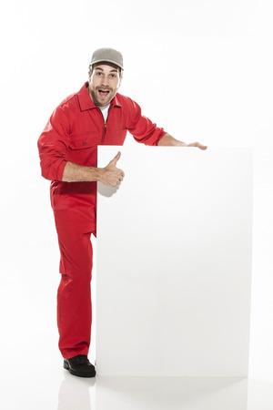 Full length portrait of a  technician in a uniform doing positiv