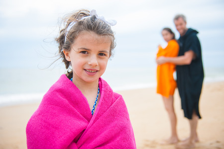 A smiling young girl look at the camera in her swimsuit. Stock Photo